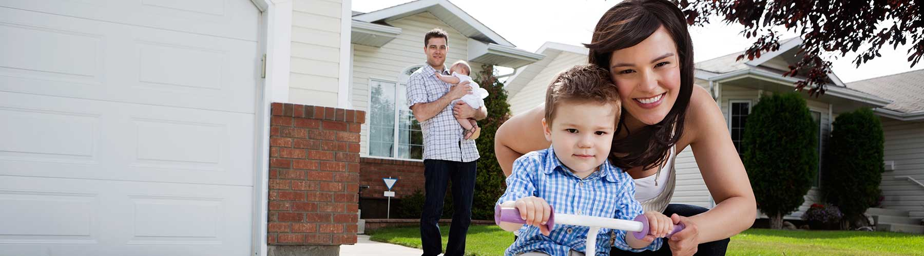 Personal insurance represented by family posing in front of their home